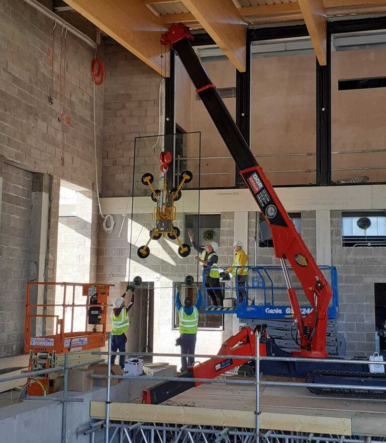 Crane putting glazing panes in place