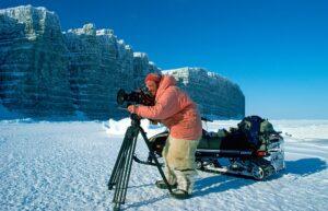 Cameraman Doug Allan filming while wearing polar bear trourser